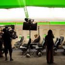 actors on film set airplane