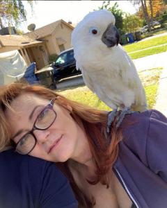 Dedee Pfeiffer with her Cockatoo